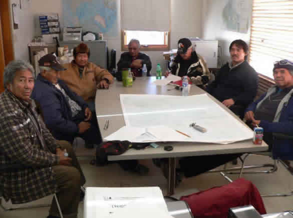 Photograph Fort Providence elders and harvesters meeting  regarding boreal caribou.