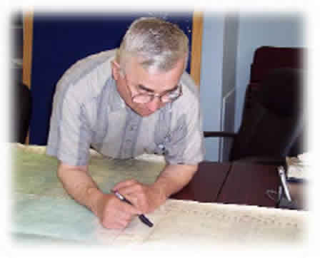 Photograph of an elder looking over a map.
